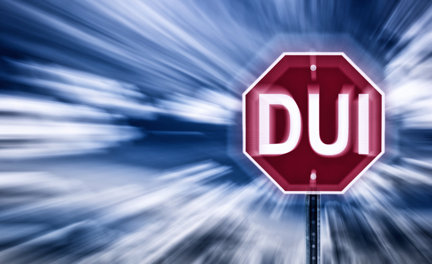 DUI stop sign in fuzzy motion background