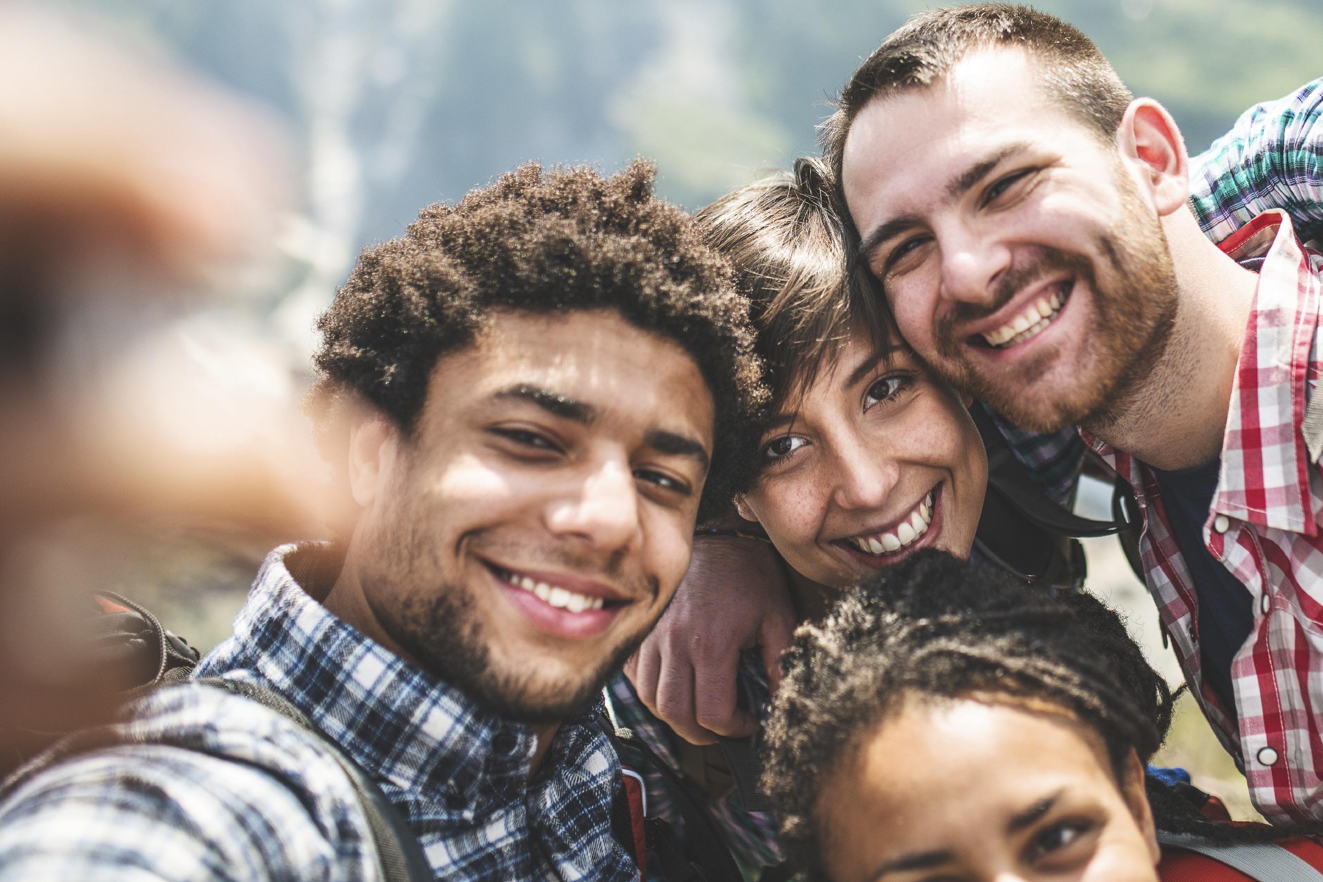 group of teens taking a selfie