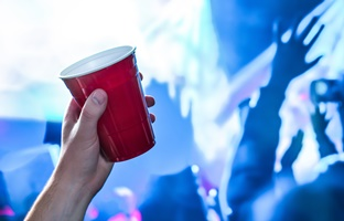 a person holding a red cup at a party