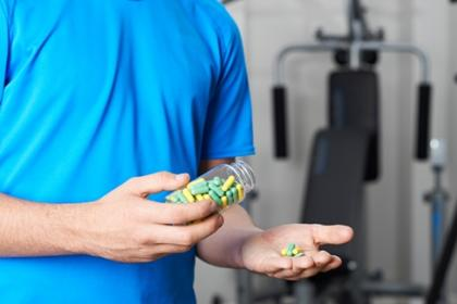 image of teen taking steroids in the gym