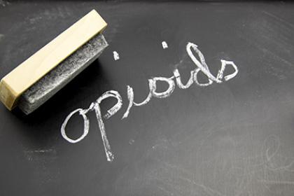"""the word """"opioids"""" written on chalkboard"""