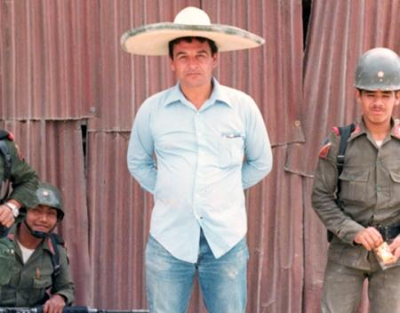 Camarena poses with Mexican law enforcement.