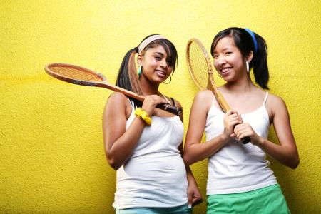 girls with tennis rackets