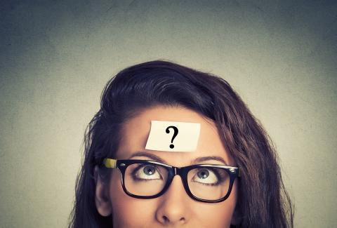 girl with question mark on forehead