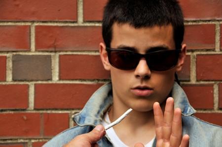image of teen turning down a marijuana joint