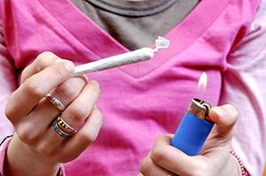 teen with marijuana joint