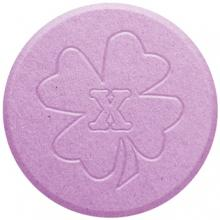image of a close up of pink ecstasy pill