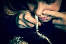 image of teen girl snorting cocaine